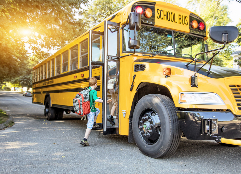 a,group,of,young,children,getting,on,the,schoolbus